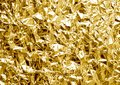 GOLD FOIL TEXTURE FOR DESIGN SHINY BACKGROUND Royalty Free Stock Photo