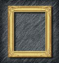 Gold frame on black slate background