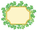 Gold frame with green shamrock Stock Image