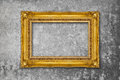 Gold Frame on grunge wall Royalty Free Stock Photo