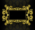 Gold frame in the rococo style on a black backgrou