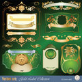 Gold-framed labels, ribbon, ornaments and elements Royalty Free Stock Images