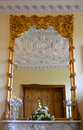 Gold framed mirror and reflection of intricate carvings Royalty Free Stock Images