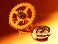 Gold gear old clockwork & e-mail Royalty Free Stock Photo