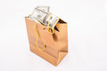 Gold gift bag with dollars Royalty Free Stock Photo