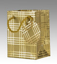 Gold gift bag with tag on grey background clipping path Stock Photos