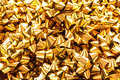 Gold gift bows a background of a closeup of golden Royalty Free Stock Photo