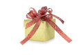 Gold gift box with red ribbon. New year gift. christmas present. Royalty Free Stock Photo