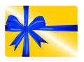 Gold gift card with blue ribbon Stock Photos