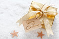 Gold gift with Merry Christmas tag Royalty Free Stock Image