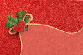 Gold gift ribbon bow on red shiny bacgkround Stock Image