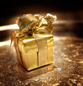 Gold gift on a silver tray Royalty Free Stock Image
