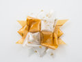Gold gift star bows with ribbon on white Royalty Free Stock Photo
