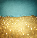 Gold glitter background and blue vintage torn paper . room for copy space.