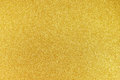 Gold glitter background filled with shiny Stock Photography