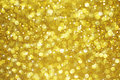 Gold glitter bokeh with stars background Royalty Free Stock Photo