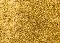 Gold glitter texture sparkling shiny wrapping paper background for Christmas holiday seasonal wallpaper  decoration, greeting Royalty Free Stock Photo