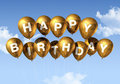 Gold Happy Birthday balloons in the sky Royalty Free Stock Photo