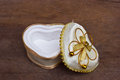 Gold heart shaped jewel box on wooden background Royalty Free Stock Photography