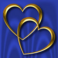 Gold Hearts on Blue Silk Stock Images