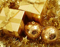 Gold holiday gifts and decoration in shiny Stock Photography
