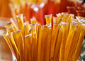 Gold Honey sticks in a glass jar Royalty Free Stock Photo