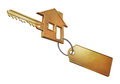 Gold house golden key shaped like a and a keychain unbranded for the logo Stock Photography