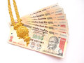 Gold and indian currency a necklace rupee on white Royalty Free Stock Image