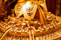 Gold jewellery in a shop window display of golden or store Royalty Free Stock Photography