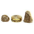 gold jewelry box and wooden figures Royalty Free Stock Photo