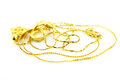 Gold jewelry pile of on white background Royalty Free Stock Images