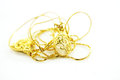 Gold jewelry pile of on white background Stock Image