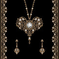 Gold jewelry set on black vintage – pendant with earrings in shape of heart and ornamental borders decorated with diamonds Royalty Free Stock Image