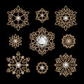 Gold jewelry set elegant of decorative elements isolated on black Stock Images