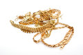 Gold jewelry on white background Stock Images