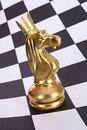 Gold knight in crown new year chess abstract concept as a year symbol Stock Photography