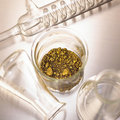 Gold in laboratory glass Royalty Free Stock Image
