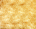 Gold lace pattern fabric Royalty Free Stock Images
