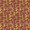Gold leaves on burgundy background. Royalty Free Stock Photo