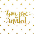 Gold lettering design for card You Are Invited Royalty Free Stock Photo