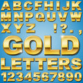 Gold letters an alphabet sit of shiny metal and numbers Stock Photo