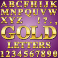 Gold letters an alphabet sit of shiny metal and numbers Stock Image