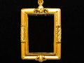 Gold locket frame pendant on black background Royalty Free Stock Image