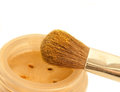 Gold make-up eyeshadows and cosmetic brush Royalty Free Stock Photo
