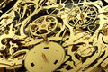 Gold mechanism, clockwork with working gears. Royalty Free Stock Photo