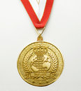 Gold medal first place winner award goal medalist ribbon the best laurel Royalty Free Stock Photos
