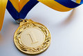Gold medal on a light background Royalty Free Stock Photo