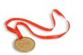 Gold medal with red ribbon Royalty Free Stock Photo
