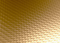 Gold metal background golden grid pattern luxury stylish and elegant metallic texture with small convex embossed squares Royalty Free Stock Photo