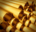 Gold metal pipes Stock Photos